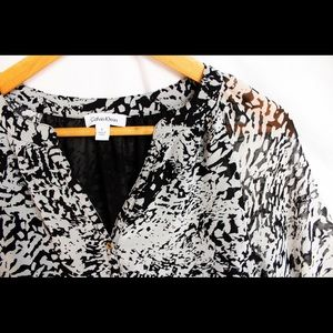 Calvin Klein • Shear Blouse • Black and white